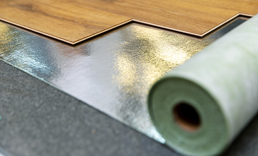 laminate floor installation in a room on foil underlay